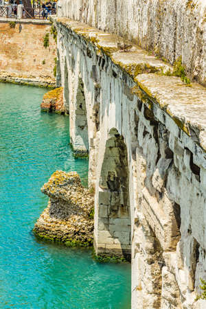 augustus: clear water under the arches of the Roman bridge of Augustus Stock Photo