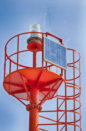 powered: red metal lighthouse powered by solar panel