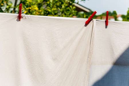 bobby: clothes hung out to dry with pegs, but after washing they are still dirty