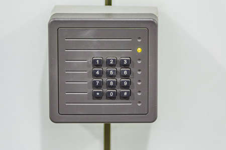 numeric: old control panel with numeric keyboard and yellow light Stock Photo