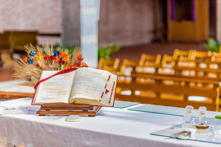 bible flower: the spirituality of an open Bible on the altar of the Catholic Church Stock Photo
