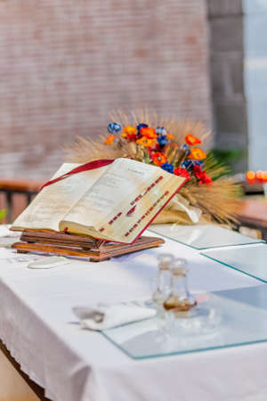 bible altar: the spirituality of an open Bible on the altar of the Catholic Church Stock Photo