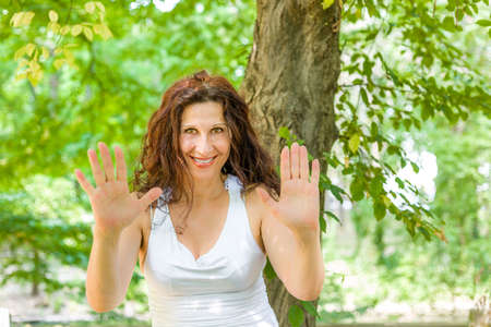 fascinating: Fascinating mature woman showing number in a green garden