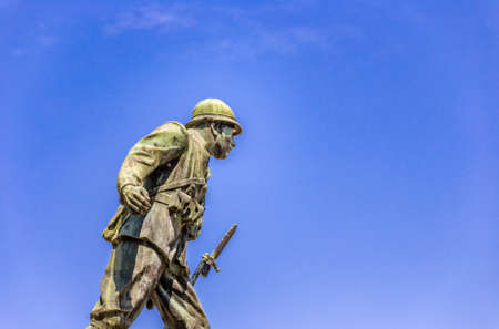 bayonet: statue of a soldier of First World War leaning forward holding a bayonet rifle Stock Photo