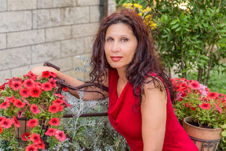 MENOPAUSE: serene woman in menopause is delighted to gardening