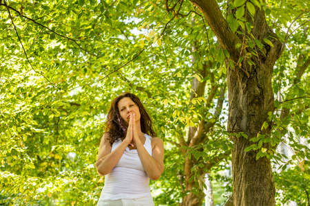 clasped: attractive woman praying with clasped hands for Blessings