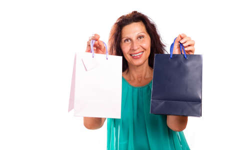 moles: Handsome mature woman with aged skin, wrinkles, spots, stains and moles holding shopping bags