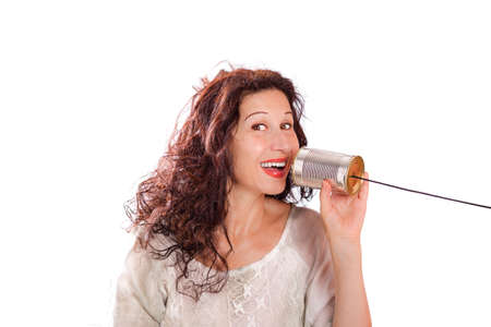 portrait of a cute middle aged woman talking with tin can phones isolated over a white background