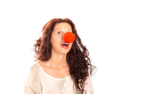 clown nose: Portrait of a senior woman with red clown nose isolated on white Stock Photo