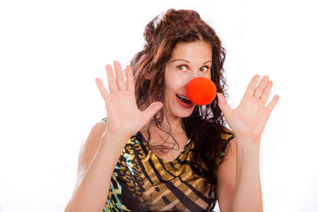 clown nose: classy mature woman wearing a red clown nose and spreading her hands