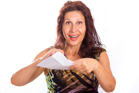 aging skin: Happy mature woman with wrinkles and aging skin opening white envelopes Stock Photo