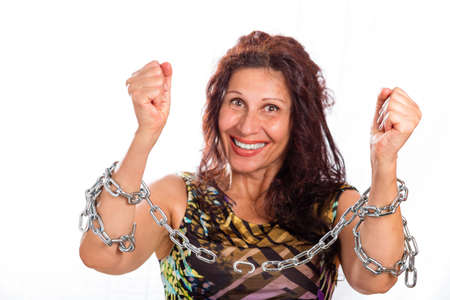 classy mature woman breaking chains isolated on white background