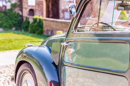 bodywork: view from behind of the sinuous line of the bodywork of vintage car Stock Photo