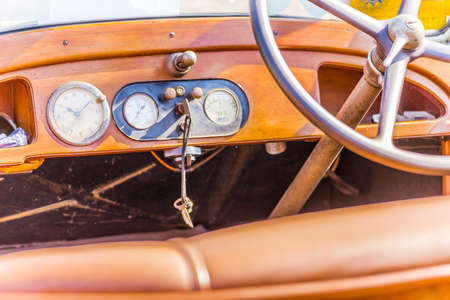 twentieth: steering wheel and dashboard of a vintage car from the early twentieth century