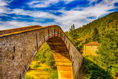 romagna: Ancient hunchback bridge in Emilia Romagna Stock Photo