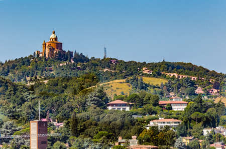 qui: panoramic view of rooftops and hills in Bologna, Italy