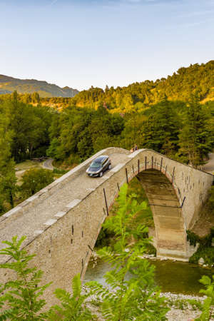 jorobado: car crossing ancient hunchback bridge in Emilia Romagna