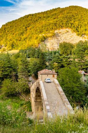 corcovado: car crossing ancient hunchback bridge in Emilia Romagna