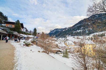 snowy promenade with view of alpine village