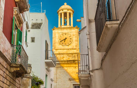 scenical: Locorotondo, Apulia, Italy, clock tower and whitewashed houses