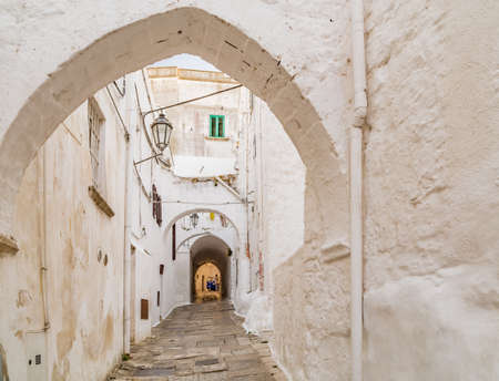 three wheels taxi in narrow streets of Ostuni, The White City 스톡 콘텐츠