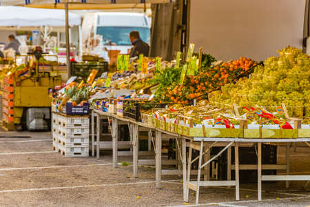 weekly market: fruit and vegetable stalls in typical weekly market in an Italian village