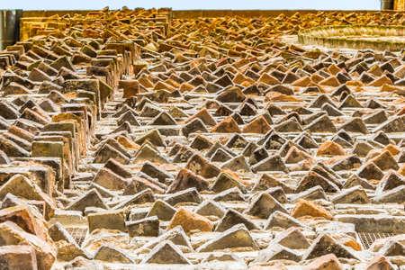 xv century: warm raw indented bricks in facade of XV century Church