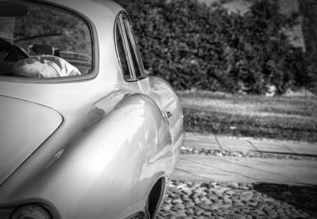 bodywork: view from behind of the sinuous line of the bodywork of vintage sports car Stock Photo