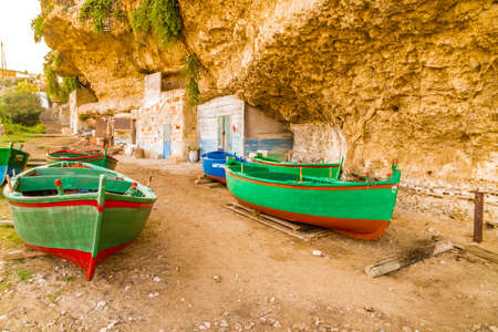 aground: Green rowing boats aground