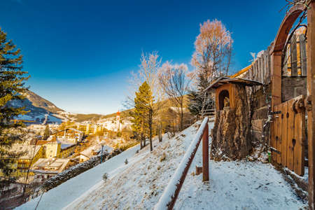 promenade with view on Alpine village in Italy