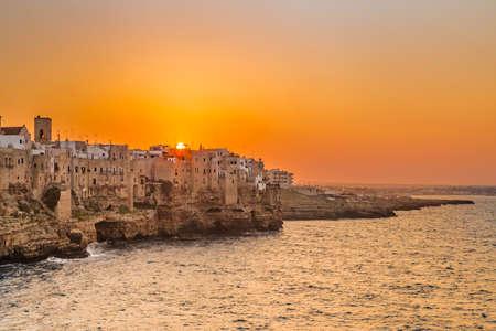 sunset on seaside village in Apulia, Italy