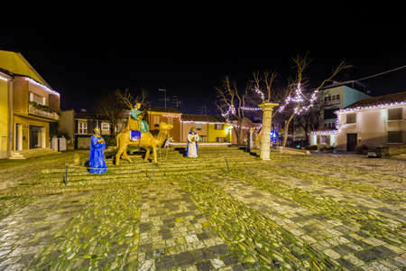 caspar: Three Wise Men in Christmas crib in old square of Italian village