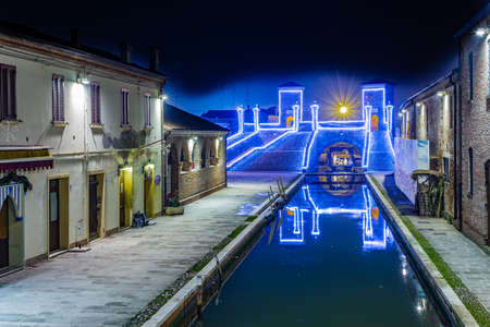 comacchio: Christmas lights on ancient bridge in Italy