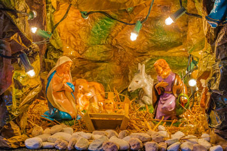 creche: Christmas nativity scene of Holy Baby Jesus in the manger with Blessed Virgin Mary and  Saint Joseph