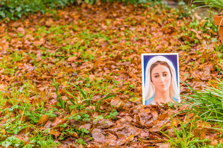 icon of the Blessed Virgin Mary on an autumnal carpet of leaves