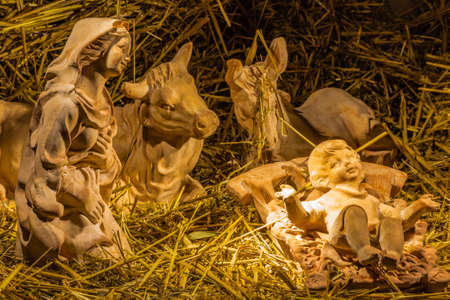 Christmas nativity scene of Holy Baby Jesus in the manger with Blessed Virgin Mary
