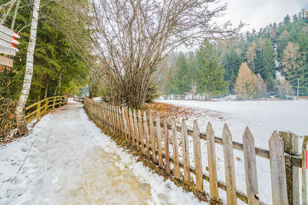 foot path: fenced foot path in winter Stock Photo