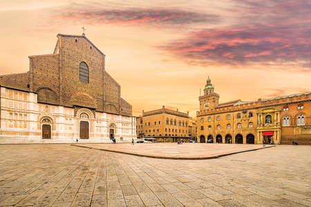 historic center of Bologna in Italy, ancient buildings and basilica in main square Stockfoto