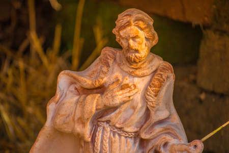creche: Statue of Saint Joseph  in Nativity scene