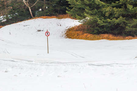 forbids: sign on snowy track forbids skiing