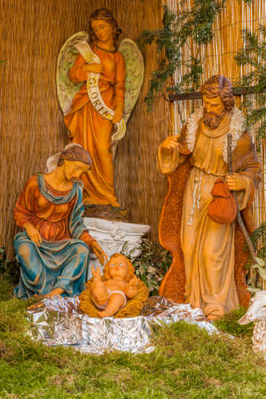 Christmas nativity scene of Holy Baby Jesus with Blessed Virgin Mary and Saint Joseph and an Angel Stock Photo