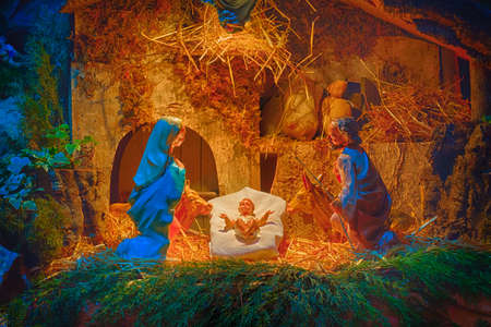 christmas nativity scene of baby jesus in the manger with saint