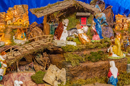 Christmas Nativity scene of baby Jesus in the manger with Saint Joseph, the Blessed Virgin Mary, the ox and the donkey
