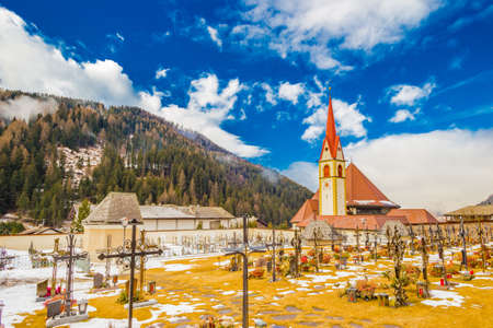 cemetery in the snow on the Dolomite Alps in Italy