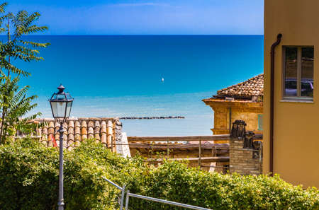 roofs of picturesque medieval village on the sea in Italy