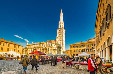 stalls of antique market in the main square of Modena in Italy Stok Fotoğraf - 75447126