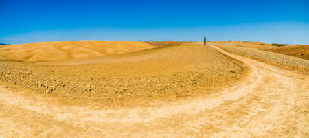 lunar landscape of Senese Clays, region of badlands under the sun of Tuscany in Italy Фото со стока