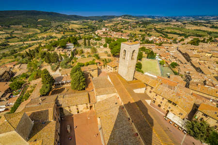 Dizzy top view of the medieval village of San Gimignano near Siena under the sun of Tuscany
