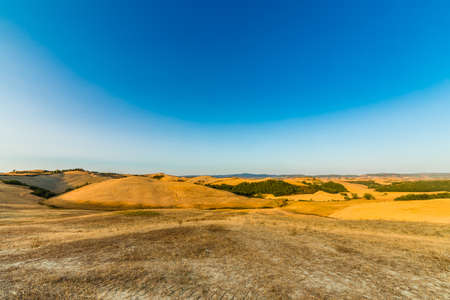 landscape of ocher clay countryside in Italy