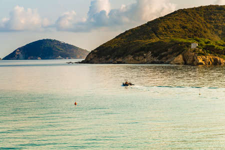 exciting panorama of clear and blue sea of Island of Elba under the sun of Tuscany in Italy